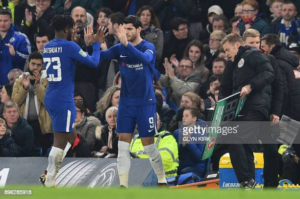 Chelsea's Belgian striker Michy Batshuayi is replaced by Chelsea's Spanish striker Alvaro Morata during the English League Cup quarterfinal football...