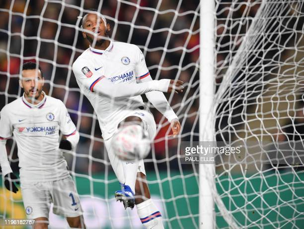 Chelsea's Belgian striker Michy Batshuayi kicks the ball into the net after scoring the opening goal during the English FA Cup fourth round football...