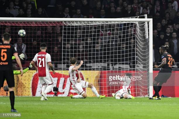 Chelsea's Belgian striker Michy Batshuayi R0 shoots and scores a goal during the UEFA Champions League Group H football match between Ajax Amsterdam...