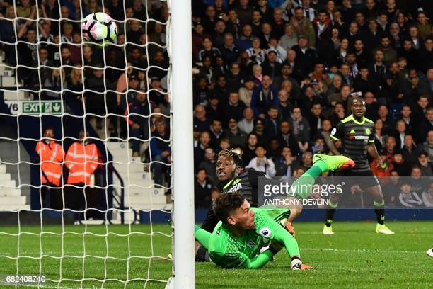 Chelsea's Belgian striker Michy Batshuayi scores the opening goal past West Bromwich Albion's English goalkeeper Ben Foster during the English...