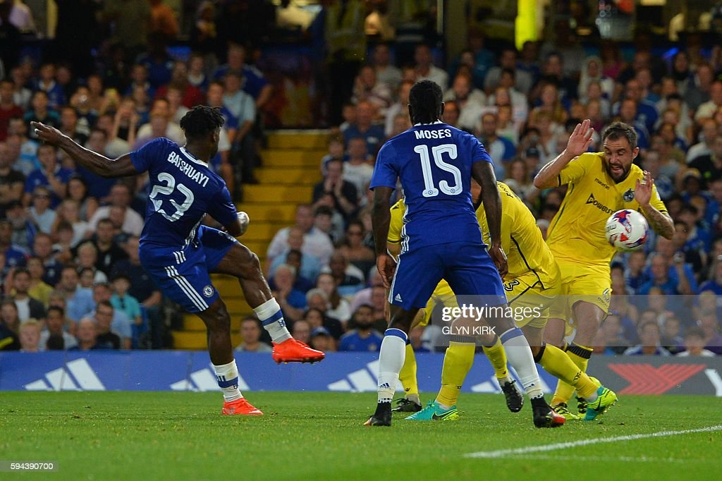 Chelsea's Belgian striker Michy Batshuayi (L) scores the opening goal during the English League Cup second round football match between Chelsea and Bristol Rovers at Stamford Bridge in London on August 23, 2016. / AFP / GLYN KIRK / RESTRICTED TO EDITORIAL USE. No use with unauthorized audio, video, data, fixture lists, club/league logos or 'live' services. Online in-match use limited to 75 images, no video emulation. No use in betting, games or single club/league/player publications. /