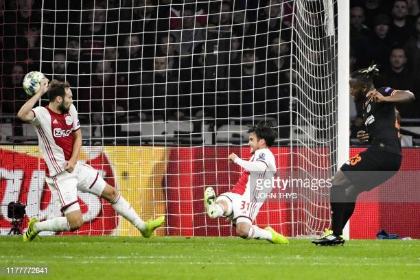 Chelsea's Belgian striker Michy Batshuayi shoots and scores a goal during the UEFA Champions League Group H football match between Ajax Amsterdam and...