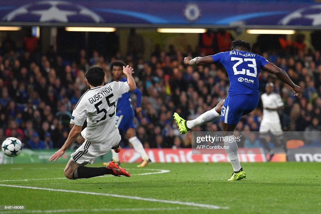 Chelsea's Belgian striker Michy Batshuayi shoots past Qarabag's Azerbaijani defender Badavi Huseynov to scores his team's fifth goal during the UEFA Champions League Group C football match between Chelsea and Qarabag at Stamford Bridge in London on September 12, 2017. / AFP PHOTO / Ben STANSALL