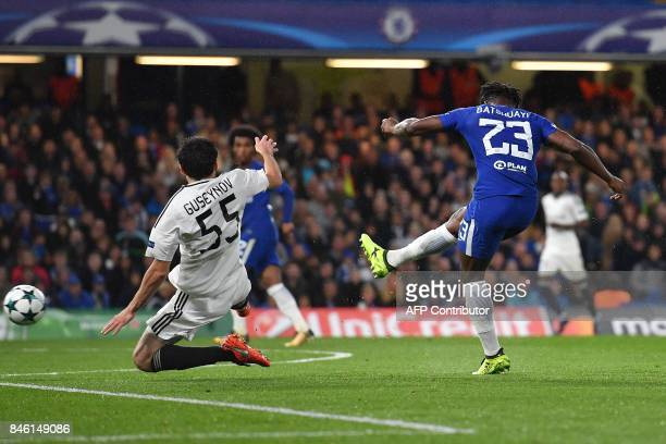 Chelsea's Belgian striker Michy Batshuayi shoots past Qarabag's Azerbaijani defender Badavi Huseynov to scores his team's fifth goal during the UEFA...
