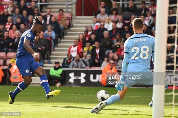 Chelsea's Belgian striker Michy Batshuayi shoots past Southampton's English goalkeeper Angus Gunn to score their fourth goal during the English...
