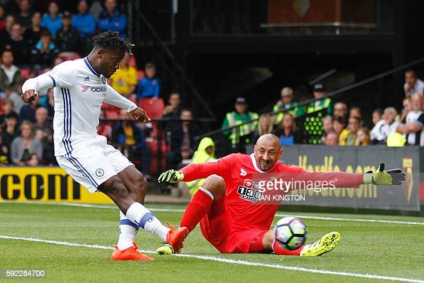 Chelsea's Belgian striker Michy Batshuayi shoots past Watford's Brazilian goalkeeper Heurelho Gomes to score the equalising goal 11 during the...