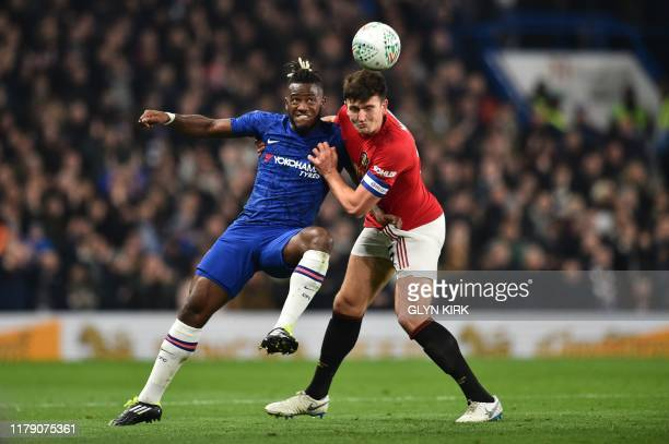 Chelsea's Belgian striker Michy Batshuayi vies with Manchester United's English defender Harry Maguire during the English League Cup fourth round...