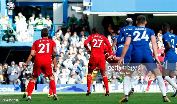 Chelsea's Belgian striker Michy Batshuayi watches the ball after heading to scores his team's second goal during the English Premier League football...