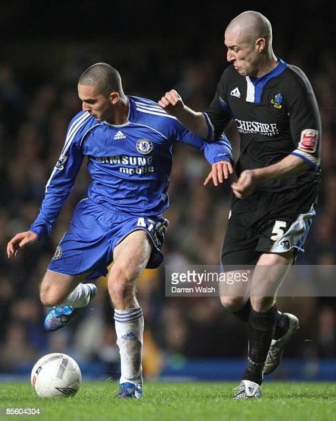 Chelsea's Ben Sahar is challenged by Macclesfield Town's Danny Swailes