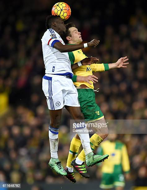 Chelsea's Bertrand Traore and Norwich City's Jonny Howson battle for the ball in the air