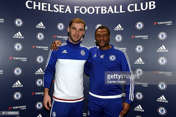 Chelsea's Branislav Ivanovic with Chelsea's Technical Director Michael Emenalo after signing a new 1 year contract with Chelsea FC at the Cobham...