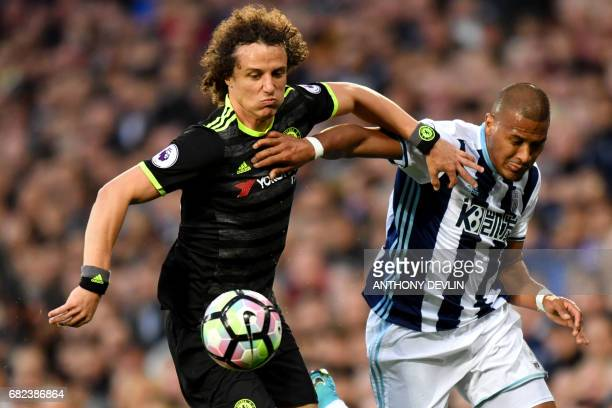 Chelsea's Brazilian defender David Luiz and West Bromwich Albion's Venezuelan striker Salomon Rondon vie during the English Premier League match...