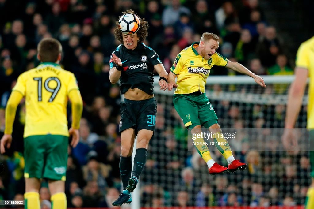 TOPSHOT - Chelsea's Brazilian defender David Luiz (L) beats Norwich City's English midfielder Alex Pritchard (R) in the air during the English FA Cup third round football match between Norwich City and Chelsea at Carrow Road in Norwich, north east England on January 6, 2018. / AFP PHOTO / Adrian DENNIS / RESTRICTED TO EDITORIAL USE. No use with unauthorized audio, video, data, fixture lists, club/league logos or 'live' services. Online in-match use limited to 75 images, no video emulation. No use in betting, games or single club/league/player publications. /