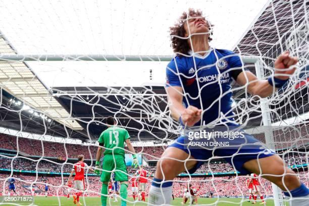 Chelsea's Brazilian defender David Luiz celebrates in the net after Chelsea's Brazilianborn Spanish striker Diego Costa scores their first goal...