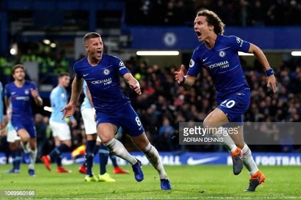 Chelsea's Brazilian defender David Luiz celebrates with Chelsea's English midfielder Ross Barkley after scoring their second goal during the English...