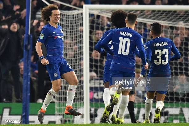 Chelsea's Brazilian defender David Luiz celebrates with teammates after scoring the winning penalty in the shootout during the English League Cup...