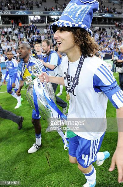 Chelsea's Brazilian defender David Luiz celebrates with their trophy after winning the UEFA Champions League final football match between FC Bayern...
