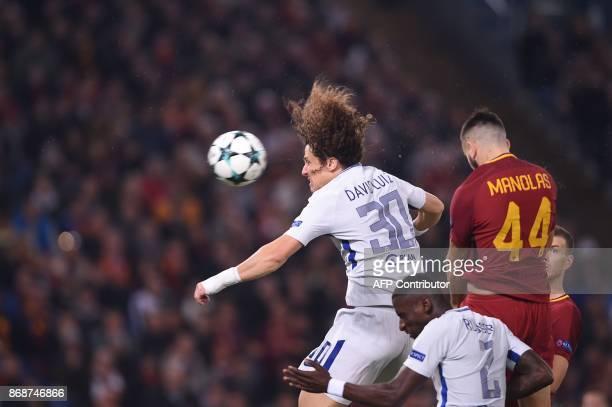 Chelsea's Brazilian defender David Luiz heads the ball next to Roma's Greek defender Kostas Manolas during the UEFA Champions League football match...