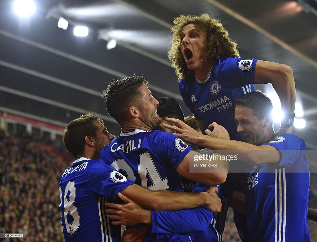 TOPSHOT - Chelsea's Brazilian defender David Luiz (2R) jumps in to celebrate their second goal scored by Chelsea's Brazilian-born Spanish striker Diego Costa (C obscured) during the English Premier League football match between Southampton and Chelsea at St Mary's Stadium in Southampton, southern England on October 30, 2016. / AFP / GLYN KIRK / RESTRICTED TO EDITORIAL USE. No use with unauthorized audio, video, data, fixture lists, club/league logos or 'live' services. Online in-match use limited to 75 images, no video emulation. No use in betting, games or single club/league/player publications. /