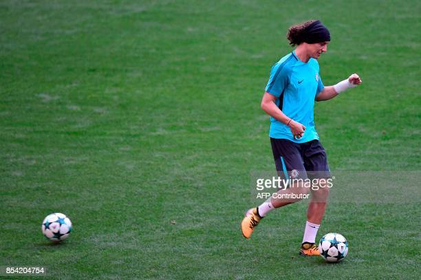 Chelsea's Brazilian defender David Luiz kicks a ball during a training session at the Wanda Metropolitano stadium in Madrid on September 26 2017 on...