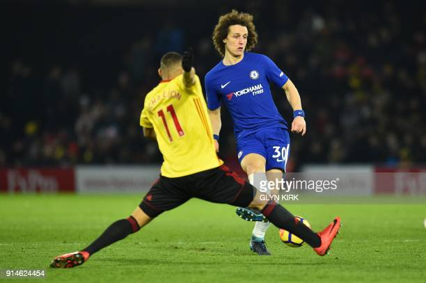 Chelsea's Brazilian defender David Luiz passes the ball by Watford's Brazilian striker Richarlison de Andrade during the English Premier League...