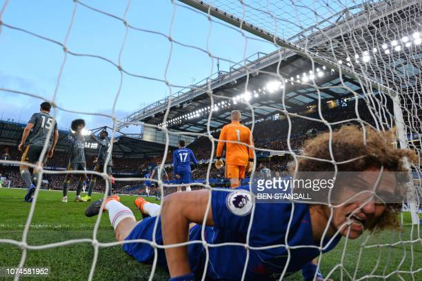 TOPSHOT Chelsea's Brazilian defender David Luiz reacts as he finds himself in the Leicester goal after missing a good chance during the English...