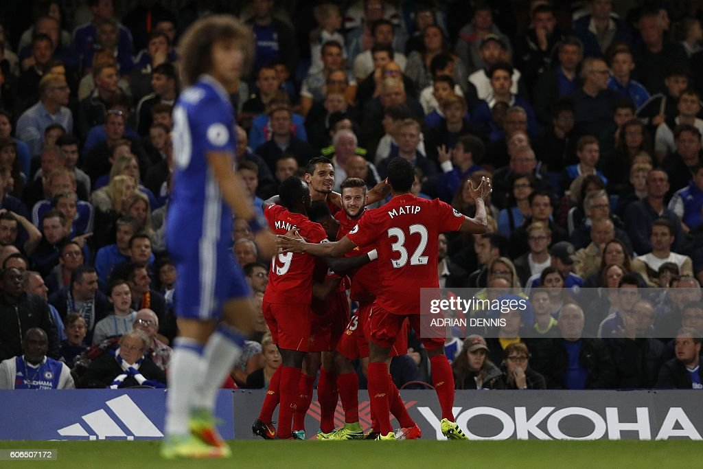 Chelsea's Brazilian defender David Luiz (L) reacts as Liverpool's Croatian defender Dejan Lovren (3L) celebrates scoring his team's first goal during the English Premier League football match between Chelsea and Liverpool at Stamford Bridge in London on September 16, 2016. / AFP / Adrian DENNIS / RESTRICTED TO EDITORIAL USE. No use with unauthorized audio, video, data, fixture lists, club/league logos or 'live' services. Online in-match use limited to 75 images, no video emulation. No use in betting, games or single club/league/player publications. /
