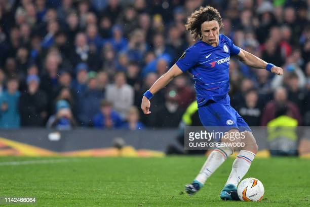 Chelsea's Brazilian defender David Luiz scores his penalty during the shootout during the UEFA Europa League semifinal second leg football match...
