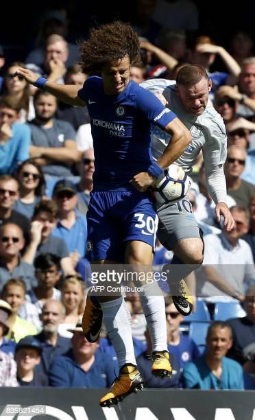 Chelsea's Brazilian defender David Luiz vie with Everton's English striker Wayne Rooney during the English Premier League football match between...