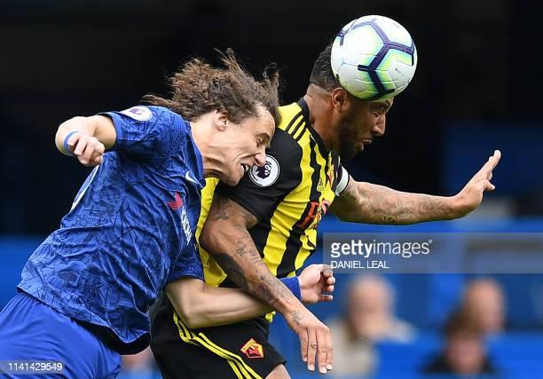 Chelsea's Brazilian defender David Luiz vies to header the ball against Watford's English striker Troy Deeney during the English Premier League...