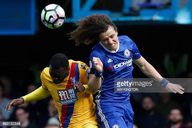 TOPSHOT Chelsea's Brazilian defender David Luiz vies with Crystal Palace's Zaireborn Belgian striker Christian Benteke during the English Premier...