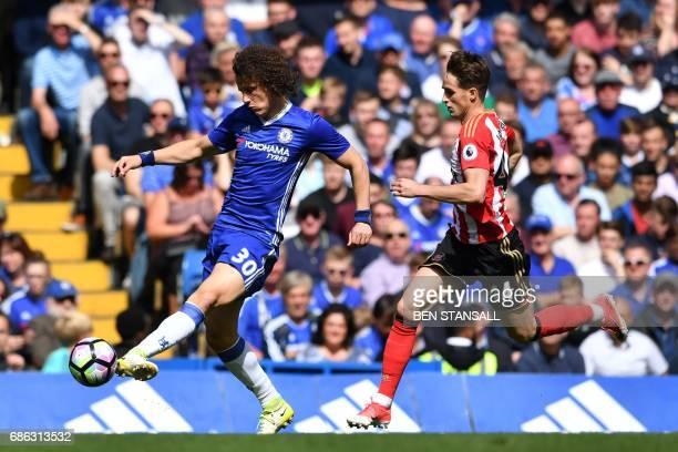 Chelsea's Brazilian defender David Luiz vies with Sunderland's Belgian midfielder Adnan Januzaj during the English Premier League football match...
