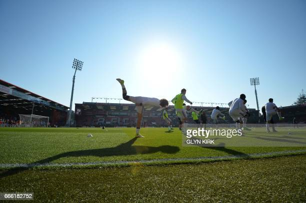 Chelsea's Brazilian defender David Luiz warms up with team mates ahead of the English Premier League football match between Bournemouth and Chelsea...