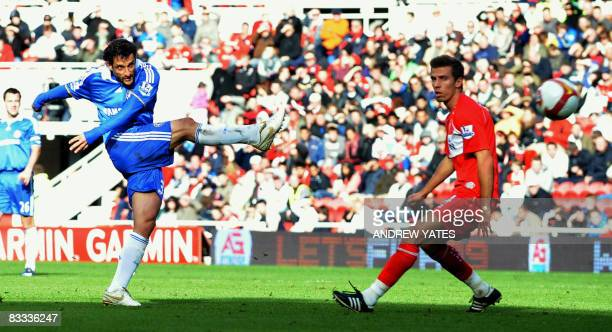 Chelsea's Brazilian defender Juliano Belletti scores the second goal during the English Premier league football match against Middlesbourgh at the...