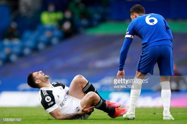 Chelsea's Brazilian defender Thiago Silva checks on Fulham's Serbian striker Aleksandar Mitrovic during the English Premier League football match...