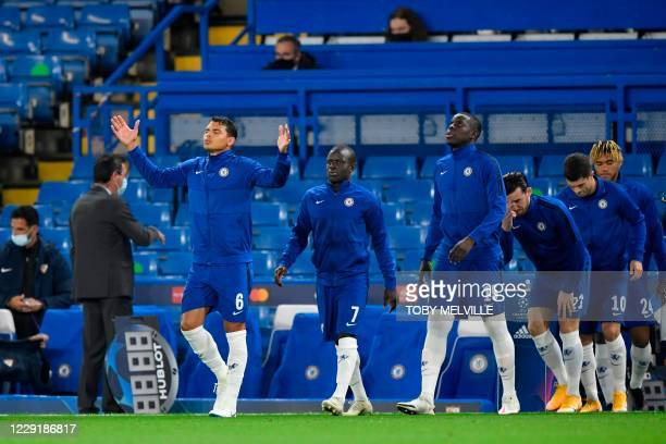 Chelsea's Brazilian defender Thiago Silva, Chelsea's French midfielder N'Golo Kante and Chelsea's French defender Kurt Zouma stride out onto the...
