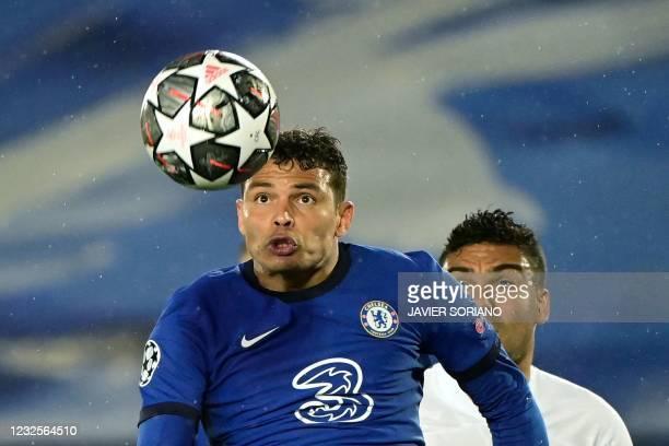 Chelsea's Brazilian defender Thiago Silva eyes the ball next to Real Madrid's Brazilian midfielder Casemiro during the UEFA Champions League...