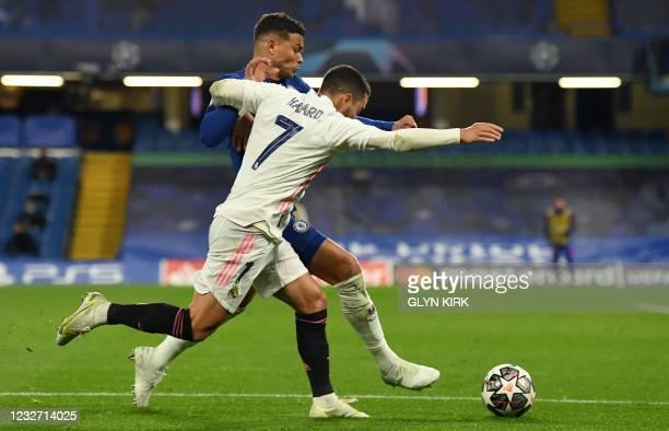 Chelsea's Brazilian defender Thiago Silva fends off Real Madrid's Belgian forward Eden Hazard during the UEFA Champions League second leg semi-final...