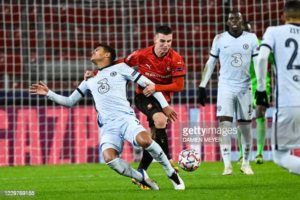 Chelsea's Brazilian defender Thiago Silva fights for the ball with Rennes' French midfielder Benjamin Bourigeaud during the UEFA Champions League...