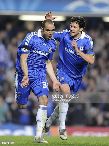Chelsea's Brazilian footballer Alex celebrates with his teammate Chelsea's German footballer Michael Ballack after scoring a goal during the UEFA...