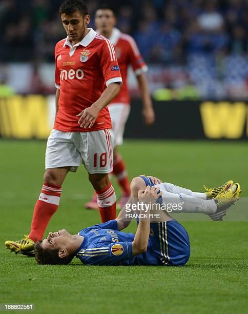 Chelsea's Brazilian midfielder Emboaba Oscar lies injured as Benfica's Argentinian forward Eduardo Salvio stands over him during the UEFA Europa...