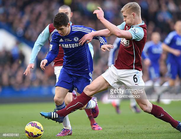 Chelsea's Brazilian midfielder Oscar in action against Burnley's English defender Ben Mee during the English Premier League football match between...