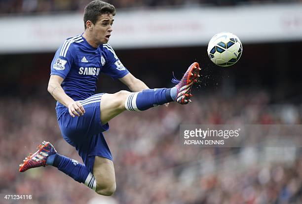 Chelsea's Brazilian midfielder Oscar passes the ball during the English Premier League football match between Arsenal and Chelsea at the Emirates...