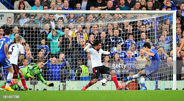 Chelsea's Brazilian midfielder Oscar scores his team's first goal during the English Premier League football match between Chelsea and Fulham at...