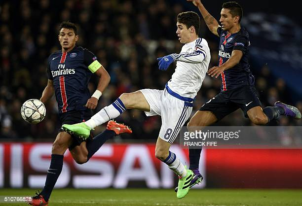 Chelsea's Brazilian midfielder Oscar shoots the ball in front of Paris SaintGermain's Brazilian defender Thiago Silva and Paris SaintGermain's...