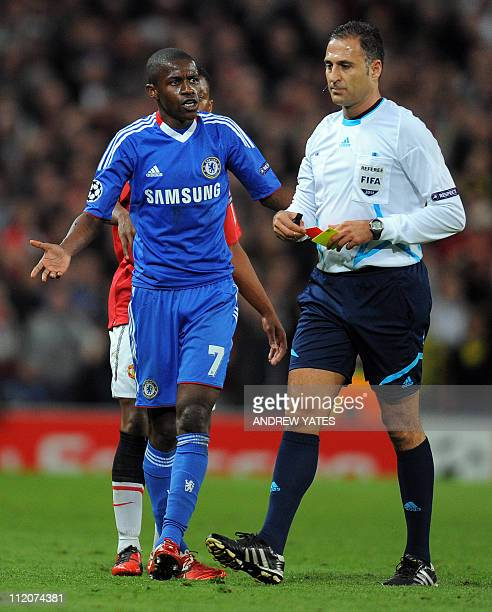Chelsea's Brazilian midfielder Ramires is sent off by referee Olegario Benquerenca after a fould on Manchester United's Portugese player Nani during...