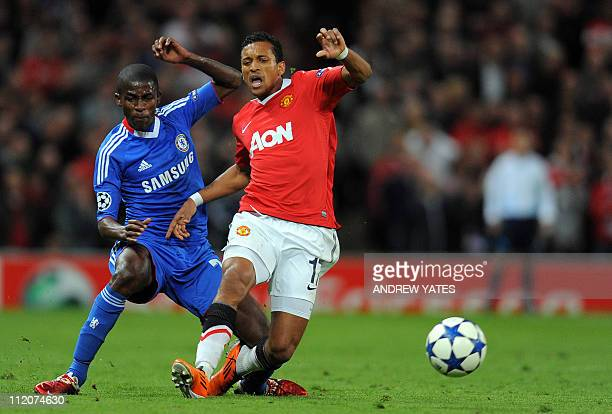 Chelsea's Brazilian midfielder Ramires is sent off by referee Olegario Benquerenca after a foul on Manchester United's Portugese player Nani during...