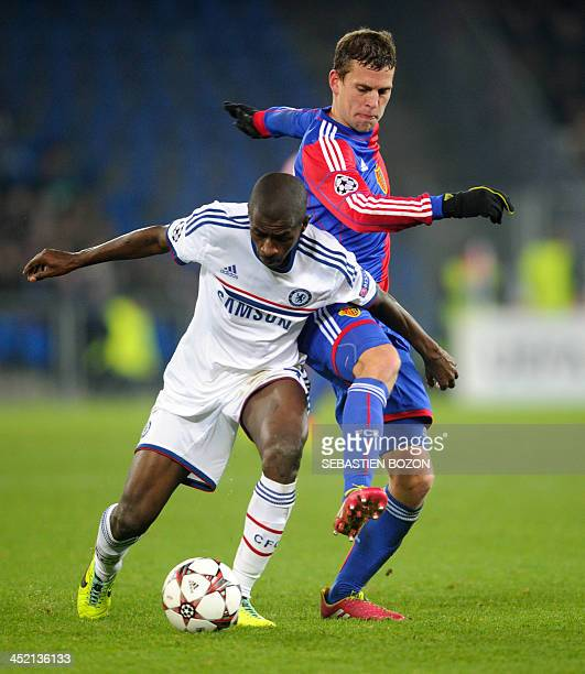 Chelsea's Brazilian midfielder Ramires vies for the ball with Basel's Swiss midfielder Fabian Frei during the UEFA Champions League group E football...
