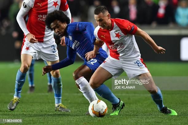 Chelsea's Brazilian midfielder Willian and Slavia Prague's Czech defender Jan Boril vie for the ball during the UEFA Europa League quarterfinal first...
