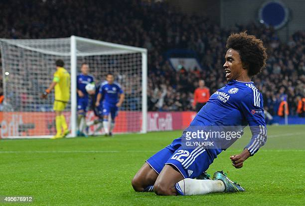 Chelsea's Brazilian midfielder Willian celebrates after scoring from a free kick during a UEFA Chamions league group stage football match between...